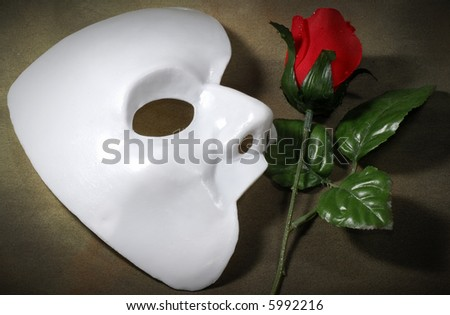 Photo of White Mask and a Fabric Rose - Opera Concept - stock photo