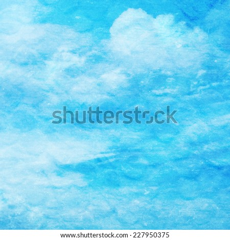 Photo of white puffy clouds combined with a rough paper texture to create a textural sky scape. - stock photo