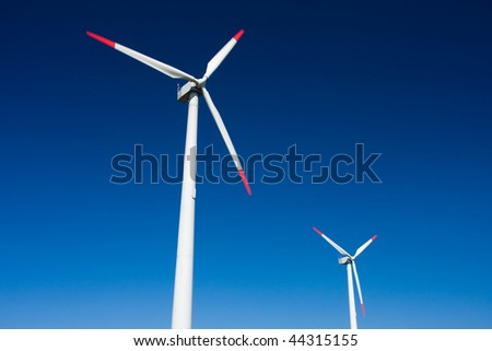 Photo of Wind power installation in sunny day - stock photo