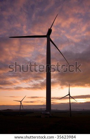 Photo of Wind power silhouette installation in sunny day