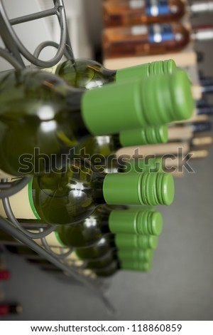 photo of wine bottles on a wine rack - stock photo