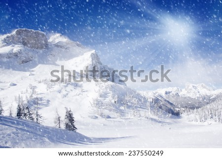 Photo of winter landscape with mountains covered by snow