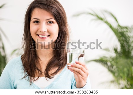Photo of woman on diet drinking healthy beverage