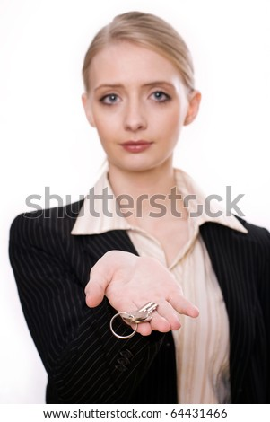 Photo of  woman's hand holding new key and pointing it at camera - stock photo