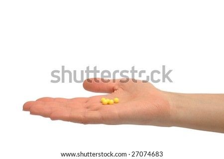 Photo of woman's hand holding pills on white background - stock photo