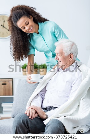 Photo of woman take care of elderly patient - stock photo