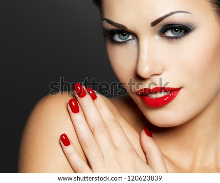 Photo of  woman with fashion red nails and sensual lips - Model posing in studio - stock photo