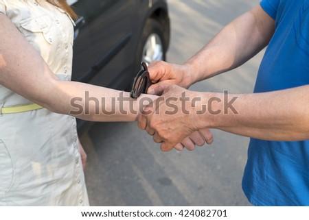 Photo of women handcuffed criminal police - stock photo