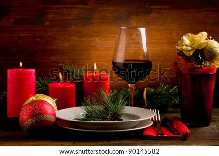 photo of wooden table with christmas ornaments illuminated by spot - stock photo