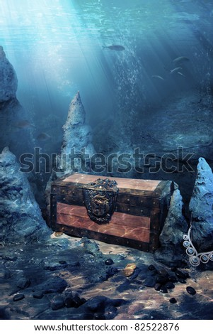 photo of wooden treasure chest submerged underwater with light rays - stock photo