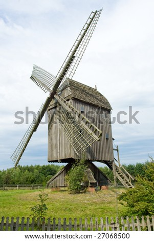 Photo of wooden windmill in Europe and blue sky