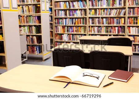 Photo of workplace in modern library of college or other educational institution - stock photo
