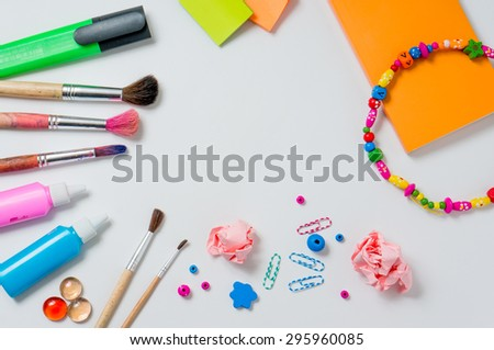 Photo of workplace with lots of stationery objects. Bright studio shot on light background. - stock photo