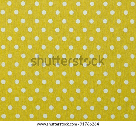 photo of yellow fabric with white polka dots - stock photo