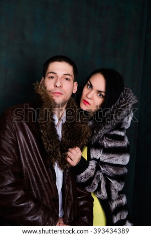 photo of Young attractive couple. Handsome man and sexy woman in fur coat