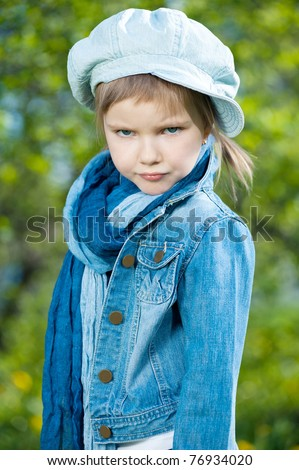 Photo of young beautiful girls in blue against a green background - stock photo