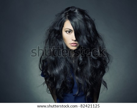 Photo of young beautiful lady with magnificent dark hair - stock photo