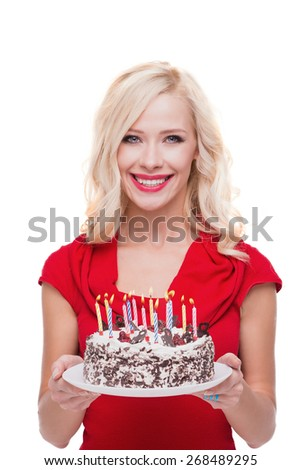 Photo of young beautiful smiling blonde woman. Woman holding cake with candles and standing on white background. Concept for happy birthday - stock photo