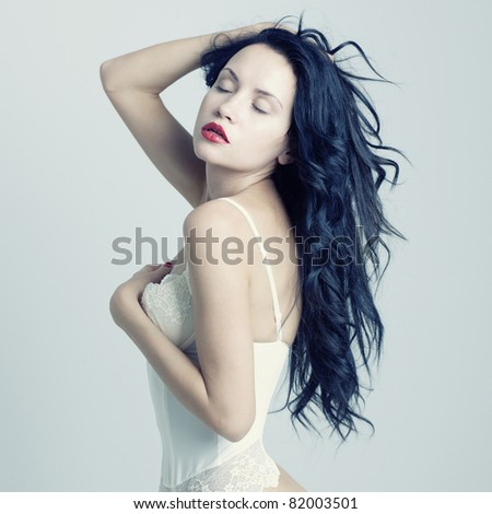 Photo of young beautiful woman with red lipstick - stock photo