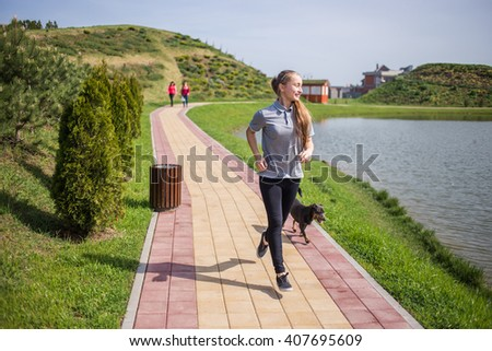 Photo of young blonde woman doing running activities - stock photo