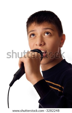 Photo of young boy singing a karaoke song - stock photo