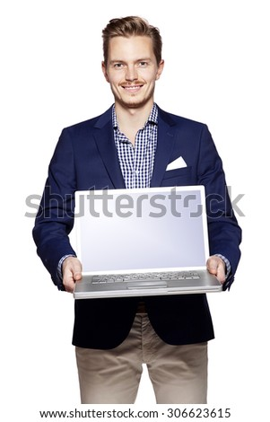 Photo of young businessman holding his laptop with copy space.  - stock photo