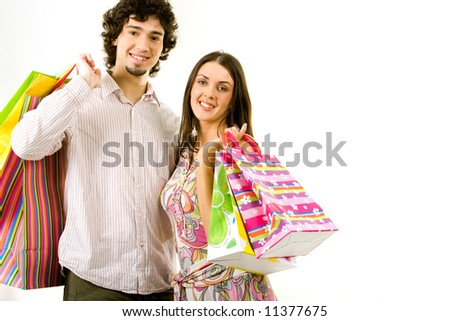 Photo of young couple with the shopping bags - stock photo