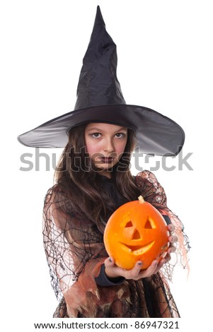 Photo of young girl in halloween costume holding a pumpkin - stock photo