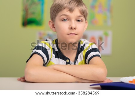 Photo of young good boy during lessons at school - stock photo
