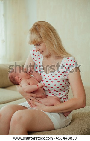 photo of young happy mother hugging baby - stock photo