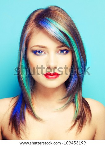Photo of young lady with bright makeup on bright background - stock photo