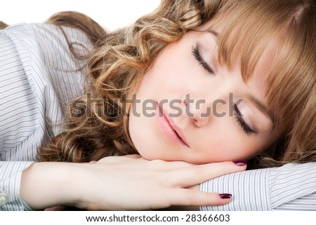 Photo of young pretty girl having a nap, isolated - stock photo