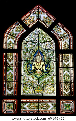 Photo og colorful glass window with Thai art at Wat Benchamabophit - the Marble Temple
