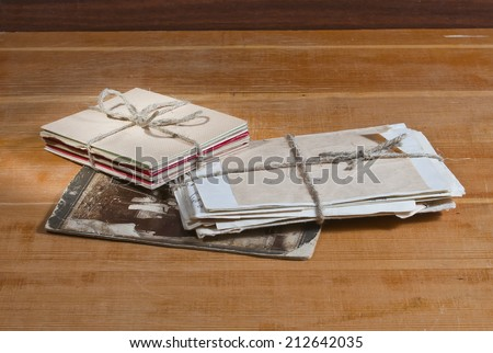 photo old letters two packs tied up by a twine and one old photo - stock photo