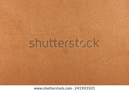 Photo orange suede texture close up.  May be used as the background. - stock photo