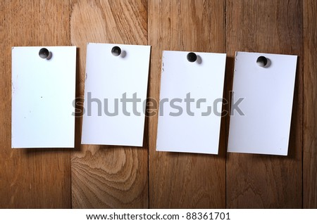 Photo paper attach nail wooden background - stock photo