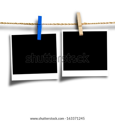 photo paper attach to rope with clothes pins isolated with clipping path
