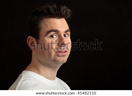 photo portrait of male in his 30's on black background