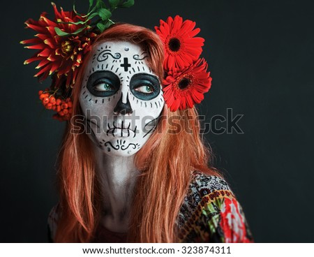 photo portrait of red haired girl with red flowers in her hair makeup Los Muertos - stock photo