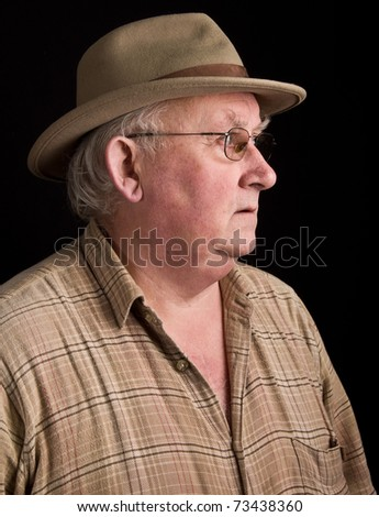 photo portrait of senior male wearing a hat - stock photo
