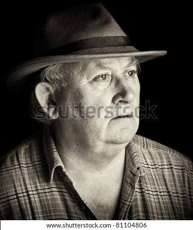 photo portrait of senior male wearing a hat