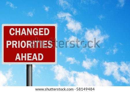 Photo realistic metallic reflective 'changed priorities' sign, with space for your text / editorial overlay. Business / political concept - stock photo