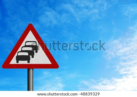 Photo realistic metallic reflective 'queues likely' sign, against a bright blue sky. With space for your text overlay / editorial