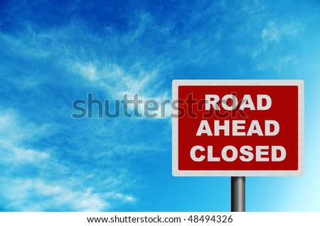 Photo realistic metallic reflective 'road closed ahead' sign, against a bright blue sky