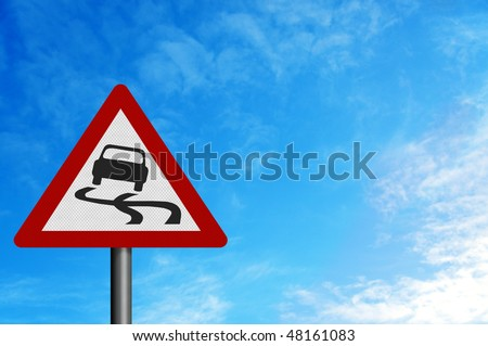 Photo realistic reflective metallic 'slippery road' sign, against a bright blue sky. - stock photo