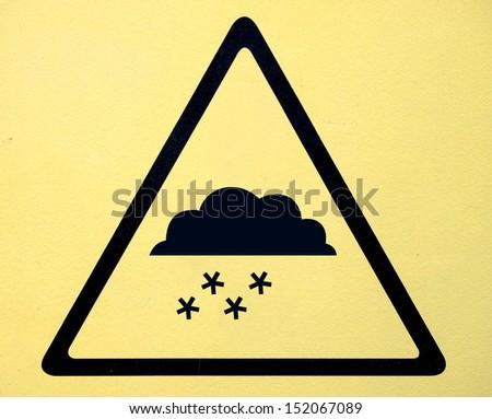 Photo realistic reflective metallic 'snow warning' sign - stock photo