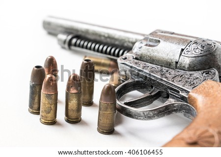 Photo revolver gun with cartridges isolated on white background. - stock photo
