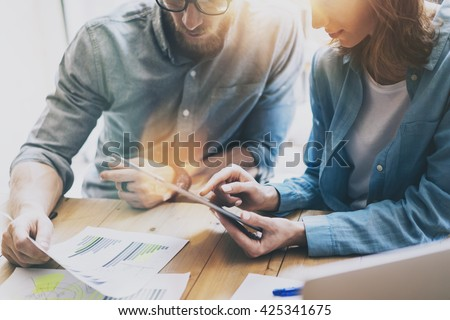 Photo Sales Manager Working Modern Studio.Woman Showing Market Report Digital Tablet.Account Department Work New Startup Project.Researching Process Wood Table.Horizontal.Burred Background.Film effect - stock photo