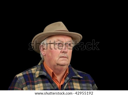 photo senior male portrait in glasses and hat - stock photo