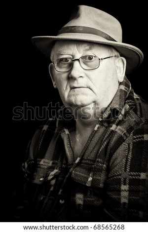 photo senior male retired wearing glasses and hat - stock photo